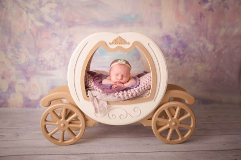 Newborn Photography - baby in toy carriage